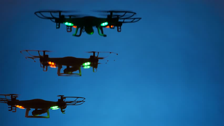 High energy drones swarm and maneuver. Note: Drones were photographed indoors, in lighting studio.