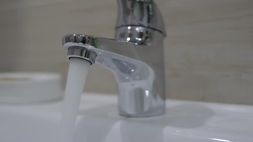 Stock Video Clip of Open faucet in bathroom, water is running ...