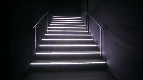 Walking by stairs in a nightclub.