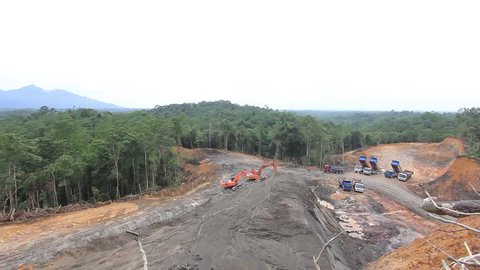 KUCHING, MALAYSIA - MAY 16 2014: Deforestation. Photo of tropical rainforest in Borneo being destroyed
