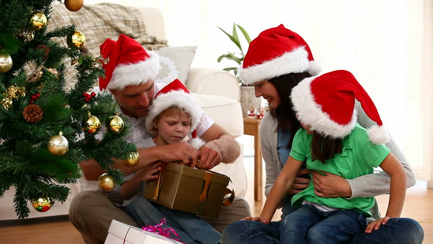 Santa Giving Christmas Presents To Two Happy Kids Stock Footage ...