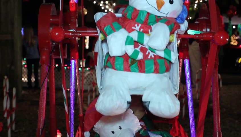 Red Neon Christmas Ferris Wheel Rotating Featuring snowman, santa claus, penguin, and reindeer toys