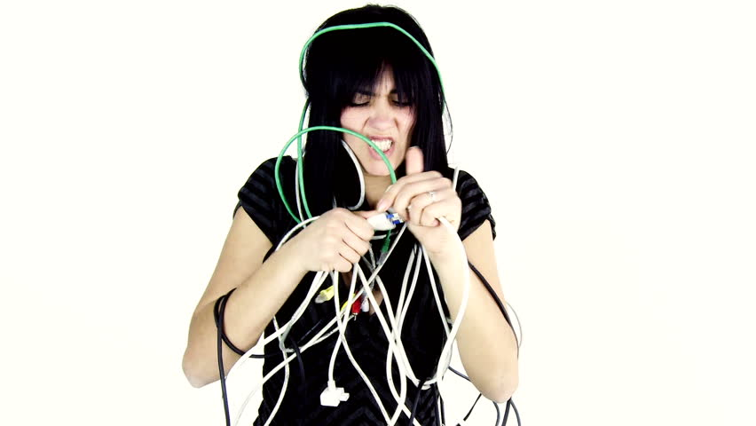 Funny woman screaming surrounded by cables not able to make them work