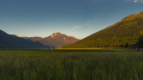 Sunset time lapse with mountains over Euklitna lake in Alaska, Anchorage