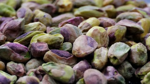 Pistachio nuts rotation in slow motion. Macro Green Pistachio. healthy food concept. drink and food background 4k. Close up colorful cleaned pistachio full hd with copy space. gourmet and organic food