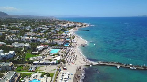 Aerial drone footage of a small coastal village  Analipsi, Hersonissos, Crete view of the village and the hotels in the neighborhood  is a Greek island in the Ionian Sea.