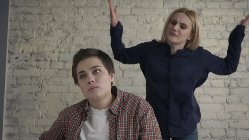 Two young lesbian girls quarrel, misunderstanding, conflict, scandal, blonde  screams at her partner. 60 fps