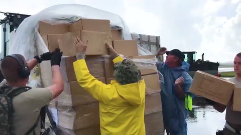 CIRCA 2010s - Water and relief supplies are delivered to victims of Hurricane Maria in Puerto Rico by the U.S. aid agencies.