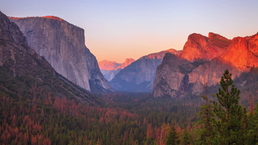 Yosemite National Park at iconic Tunnel View overlook. Front view of popular El Capitan and Half Dome at sunset in California, United States. Sunset time lapse with changing light to dark night. | Shutterstock HD Video #1006663753
