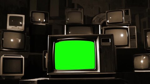 Vintage TV with green screen. Sepia Shot.  Ready to replace green screen with any footage or picture you want.