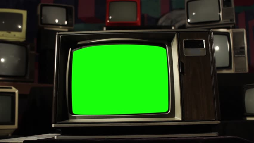 Old TV with Green Screen. The shot changes from black and white to color.  Ready to replace green screen with any footage or picture you want.   | Shutterstock HD Video #1006715743