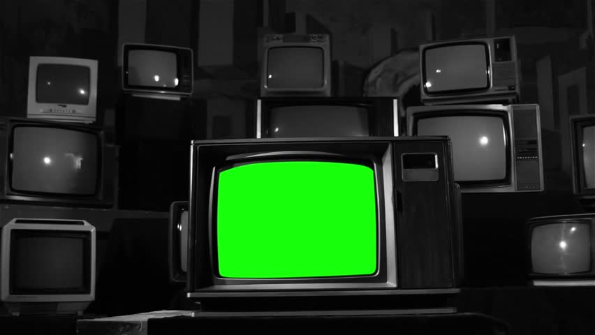 Retro Television with Green Screen and Many Old TVs. Dolly Shot. Black and White Tone changes to Color.  | Shutterstock HD Video #1006715743