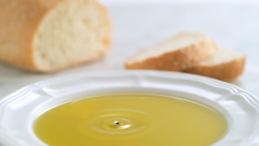 Balsamic vinegar dripping into olive oil. Shot with high speed camera, phantom flex 4K. Slow Motion.