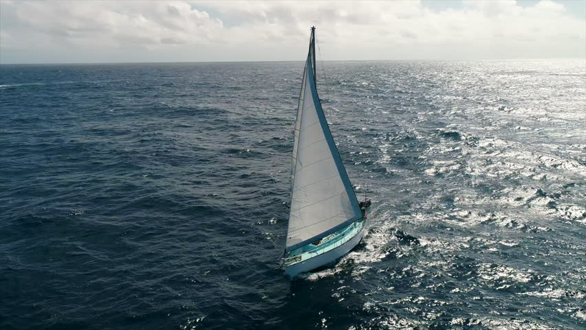 Sailboat yacht traveler sails over open sea in the beautiful caribbean sea | Shutterstock HD Video #1006757413