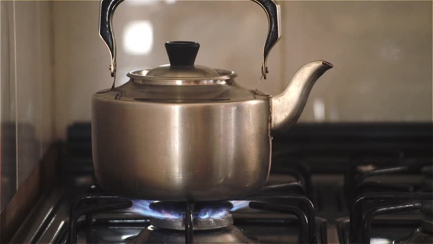 Old Kettle Boiling On Gas Stove