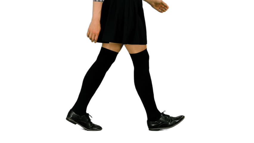 Side view walking female legs in mini skirt and black stockings, alpha channel