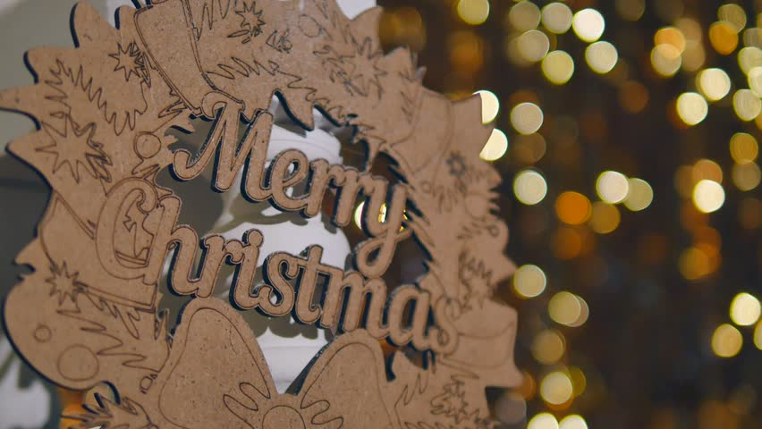 Wooden sign with text Merry christmas on the background of Christmas lights   Shutterstock HD Video #1006901683