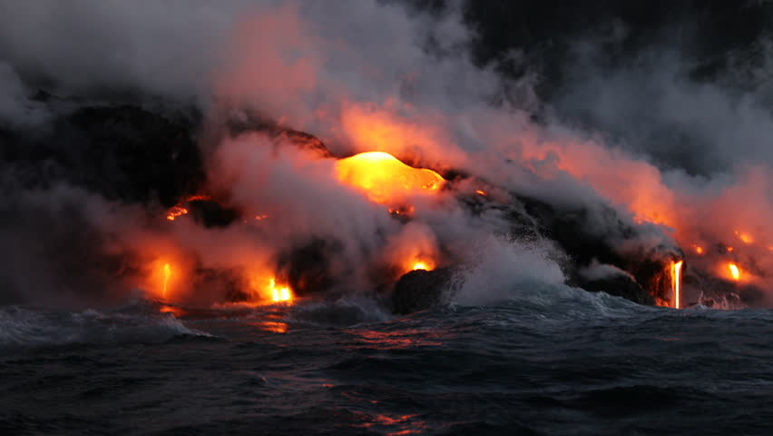 Hawaii Lava ocean close up - Lava running in the ocean from Kilauea volcano, Hawaii. Lava stream seem from lava boat tour flowing from volcanic eruption on Big Island, USA. Dawn Slow motion.