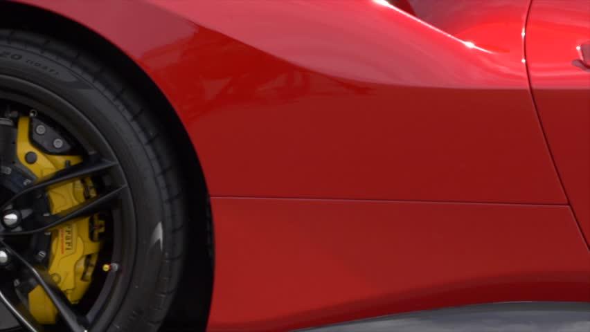 Panning shot of sleek, luxury car passenger side.