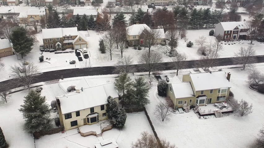 Aerial view of a suburban neighborhood during a snow storm