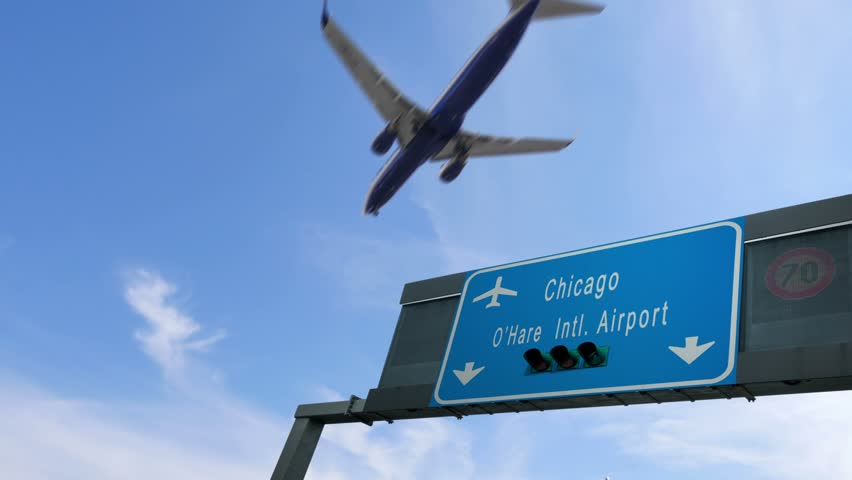 airplane flying over chicago airport signboard
