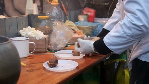 Man cooking vegetables on dirty table at cheap eatery, product quality control