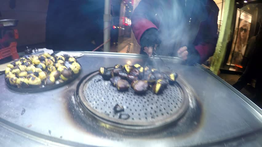 Roasted auburn cooking by peddlar on barbecue Turkish fast food in touristic Taksim, Istanbul | Shutterstock HD Video #10070513