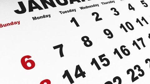 Detail on generic desk calendar passing month sheets