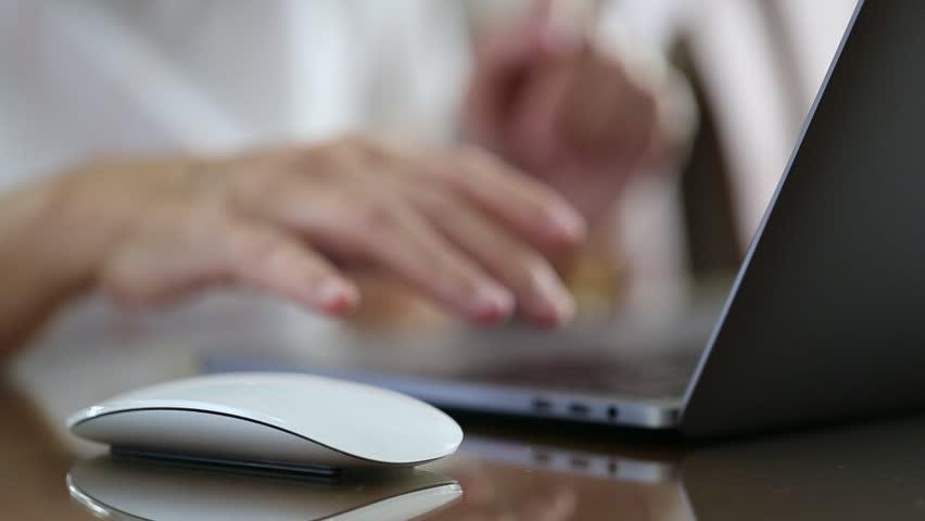Closeup woman working with computer laptop closeup on desk blur background | Shutterstock HD Video #1007122663
