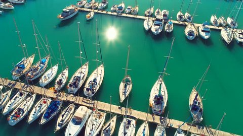 Pier speedboat. A marina lot. This is usually the most popular tourist attractions on the beach .Yacht and sailboats moored at the quay . Aerial 4k cinematic  helicopter view . Top view harbor