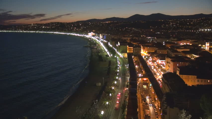 Aerial view of amazing Nice panorama at twilight, traffic car on touristic coastline