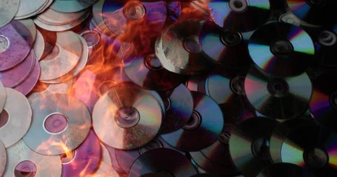 compact discs melt under the powerful hot flame of fire