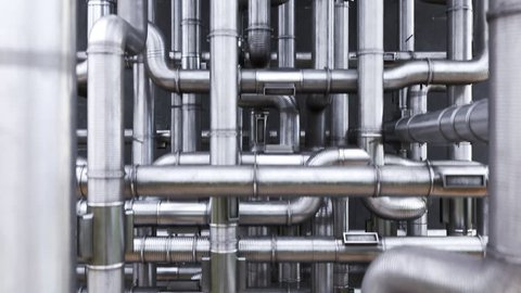 03168 Loopable animation of camera moving over the maze of clean pipes tangled together.