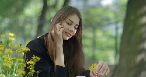 Cute attractive girl with natural make-up and wonderful smile is happily  talking via the 392d58128