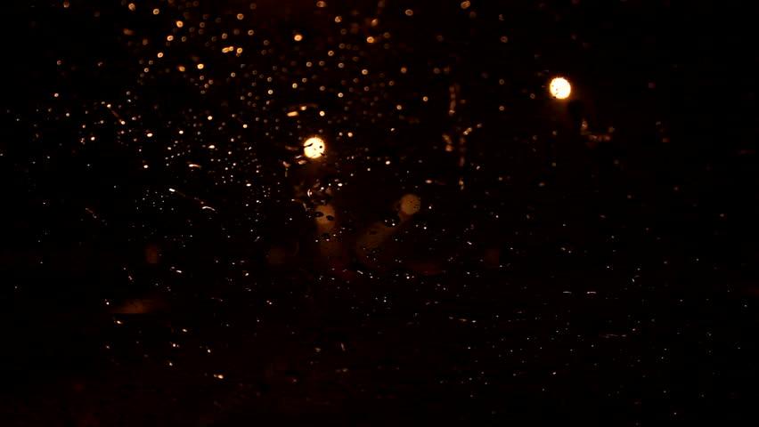 Rain drops on the windshield at night. | Shutterstock HD Video #1007177323