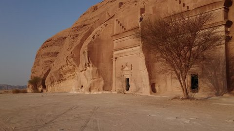 AlUla, Al Madinah Region / Saudi Arabia- September 23, 2017: Gimbal shot of a series of tombs at the Qasr al Bint area of Mada'in Saleh, the second largest settlement of the ancient Nabatean people.