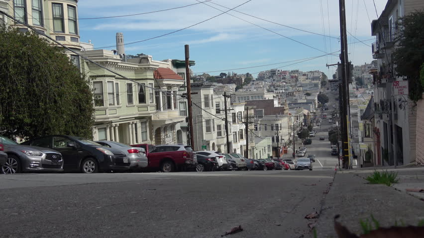 San Francisco - North Beach with a view towards Coit Tower. Residential traffic on Green Street.
