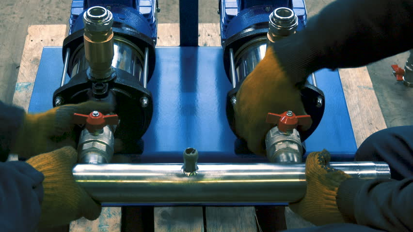 Assembling of water pumps on the factory by industrial workers | Shutterstock HD Video #1007275303