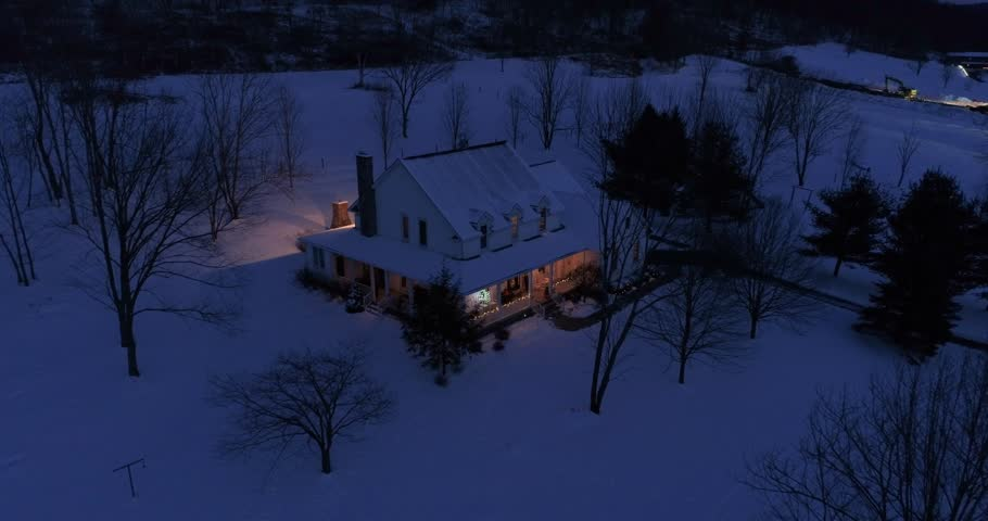 A high angle night aerial perspective of a farmhouse decorated for Christmas in the Pennsylvania countryside. Pittsburgh suburbs.