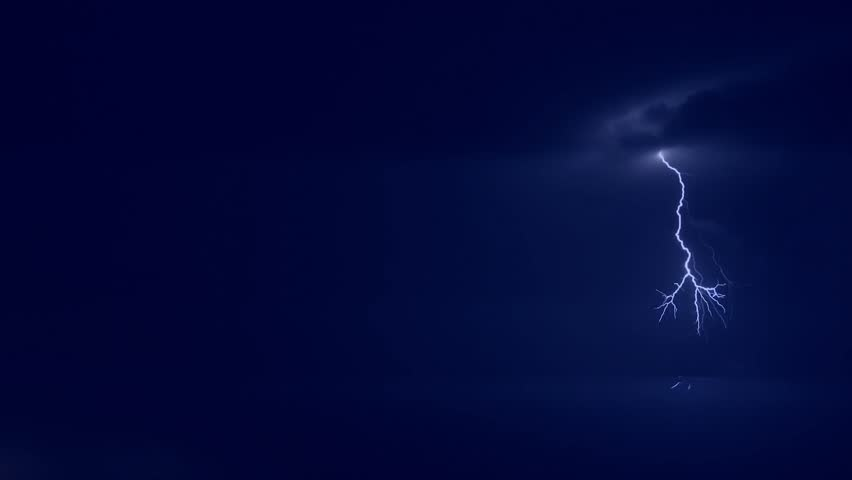 LIGHTNING BOLT IN DARK NIGHT SKY, BLUE POWER STRIKE. Thunderstorm clouds at night with lightning. Timelapse. Several lightning strikes over black background. Blue. Electrical Storm. ULTRA HD. | Shutterstock HD Video #1007317093