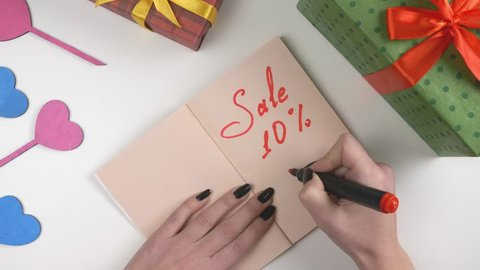 Valentine's Day, illustration, woman's hand writes in a dark brown notebook, sale 10 percent off 60 fps