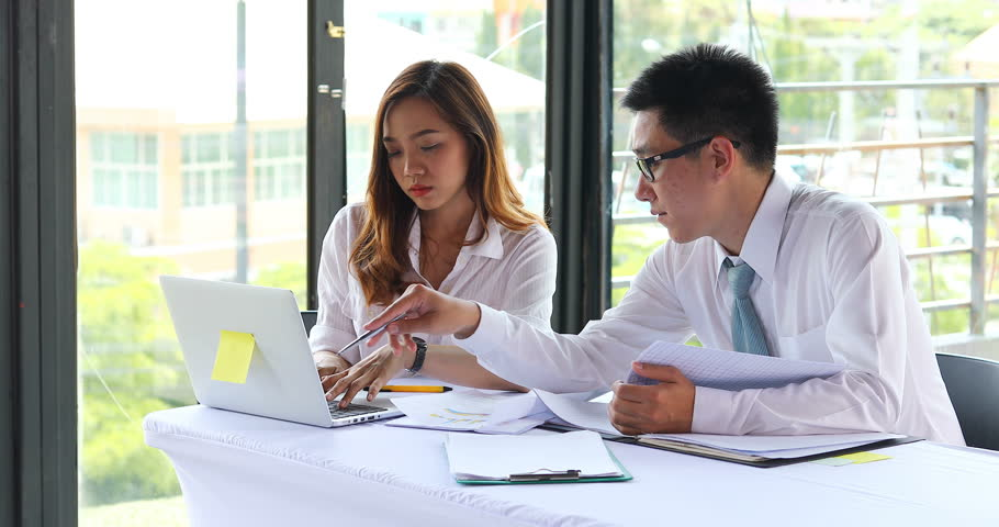 Asian business man and woman working team in office | Shutterstock HD Video #1007342713