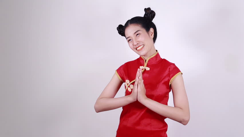 woman wear red cheongsam and pay respect in concept of happy chinese new year