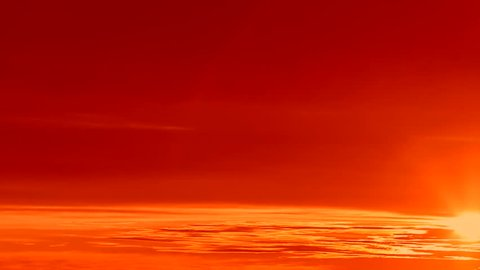Beautiful sunset in evening time, real sun disk move in horizon. A time lapse of the large orange sunset as the massive sun sets into the horizon above the ocean, Sunset sky clouds. Sunset sky. 4K.