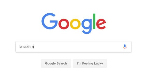 Computer screen displays bitcoin news search query on Google search website. Google is the most-used search engine on the Internet, Google.com was the most visited website in 2017. FullHD video clip