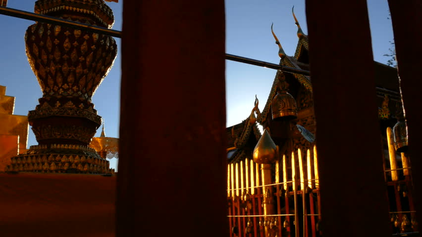 4K Golden Buddhist bell for prayer wishes in sunlight at Wat Phra That Doi Suthep temple, Chiang Mai, Thailand. Wat Phra That Doi Suthep popular famous tourist temple attraction landmark in Chiangmai.   Shutterstock HD Video #1007450473