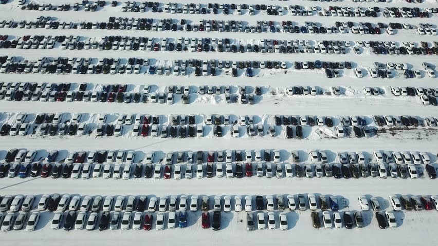 Aerial view of new car storage parking. Market for sales in winter. | Shutterstock HD Video #1007521354