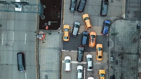 aerial over cars in traffic on Manhattan street zooming out in New York City NYC 1080 HD