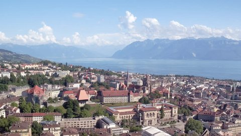 Lausanne Switzerland iconic view aerial shot / Beautiful aerial panorama of Lausanne, with cathedral, lake and mountains in the background