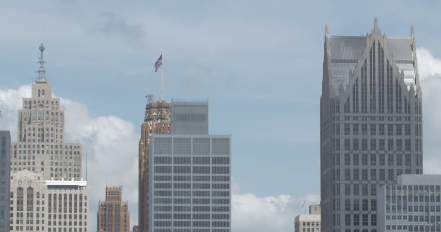 Cloud shadows moving over close rooftops of the Penobscot, Guardian, and One Detroit Center buildings in Detroit.